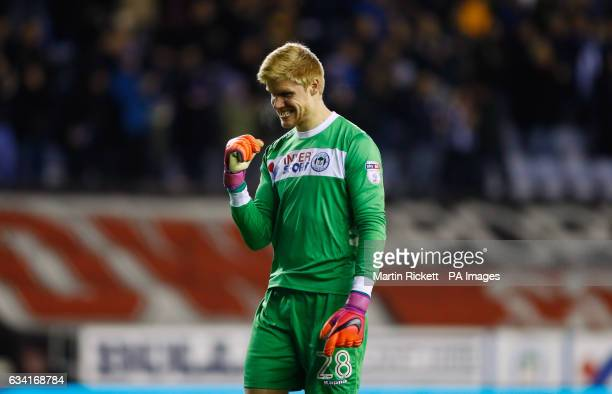 Wigan Athletic goalkeeper Jakob Haugaard celebrates after Omar Bogle scores his side's second goal of the game during the Sky Bet Championship match...