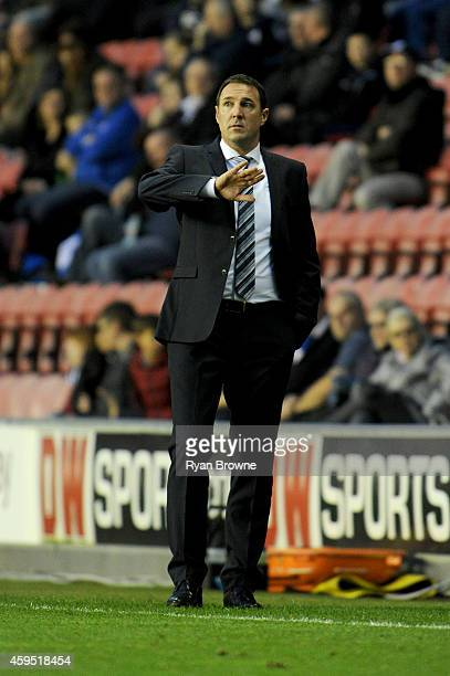 Wigan Athletic manager Malky Mackay communicates with players during the Sky Bet Championship match between Wigan Athletic and Middlesbrough at DW...