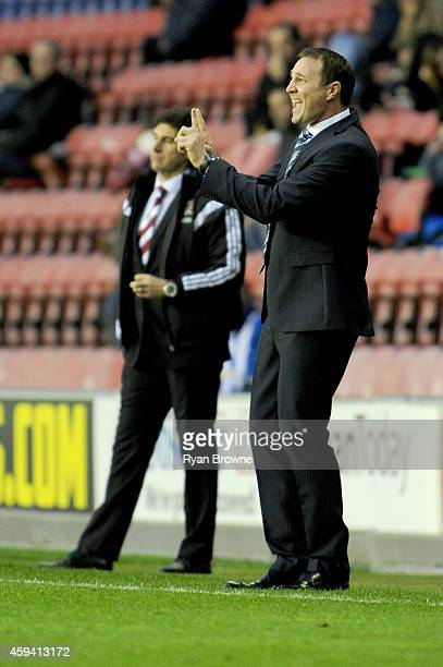 Wigan Athletic Manager Malky Mackay gestures during the Sky Bet Championship match between Wigan Athletic and Middlesbrough at DW Stadium on November...