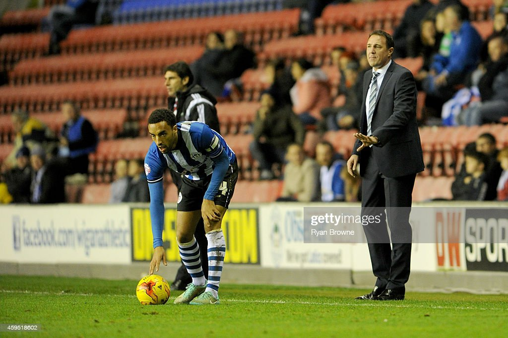 Wigan Athletic manager Malky Mackay talks to Ivan Ramis during the Sky Bet Championship match between Wigan Athletic and Middlesbrough at DW Stadium...