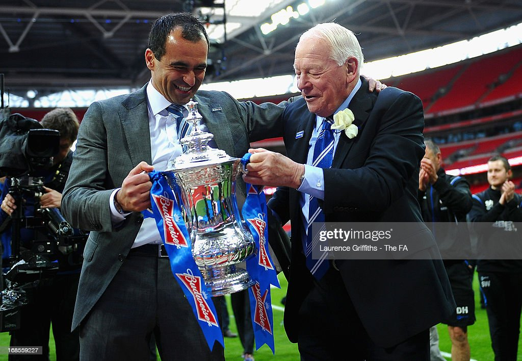 Wigan Athletic manager Roberto Martinez and Wigan Athletic Chairman Dave Whelan celebrate victory in the FA Cup with Budweiser Final match between Manchester City and Wigan Athletic at Wembley Stadium on May 11, 2013 in London, England.