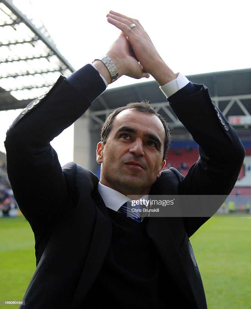 Wigan Athletic manager Roberto Martinez applauds the supporters following the Barclays Premier League match between Wigan Athletic and Aston Villa at DW Stadium on May 19, 2013 in Wigan, England.