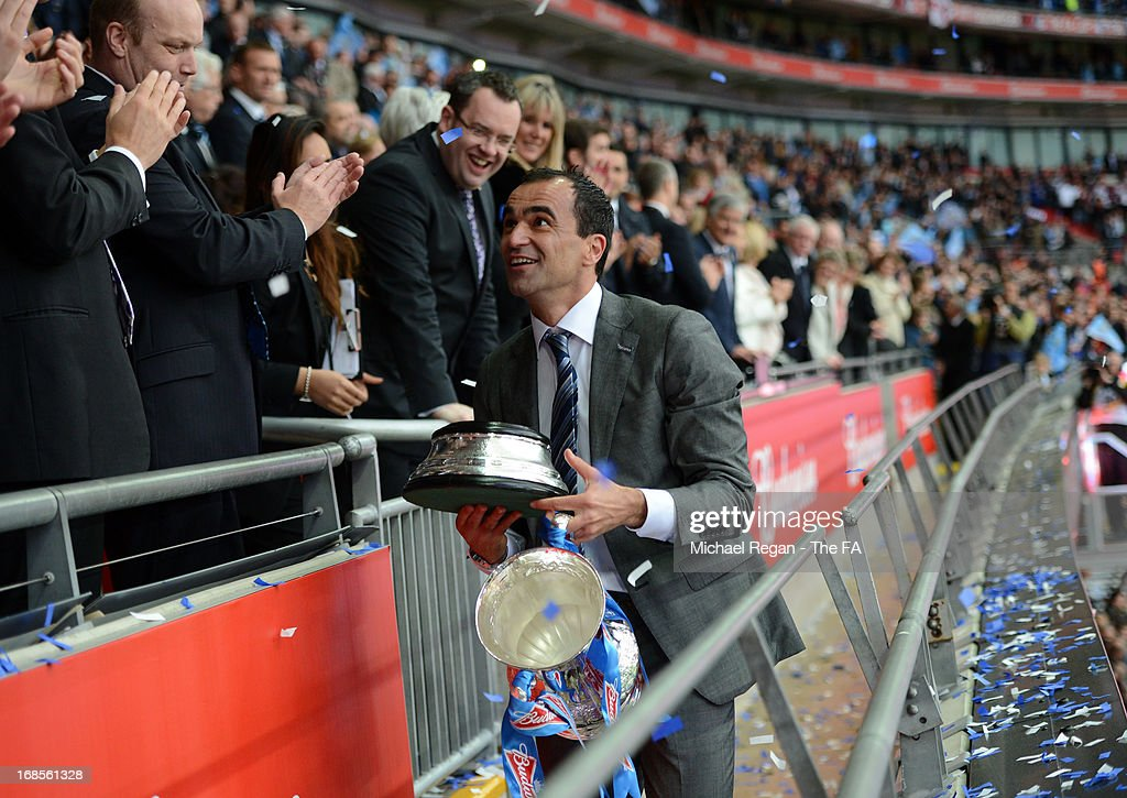 Wigan Athletic manager Roberto Martinez celebrates with the trophy after victory in the FA Cup with Budweiser Final match between Manchester City and Wigan Athletic at Wembley Stadium on May 11, 2013 in London, England.