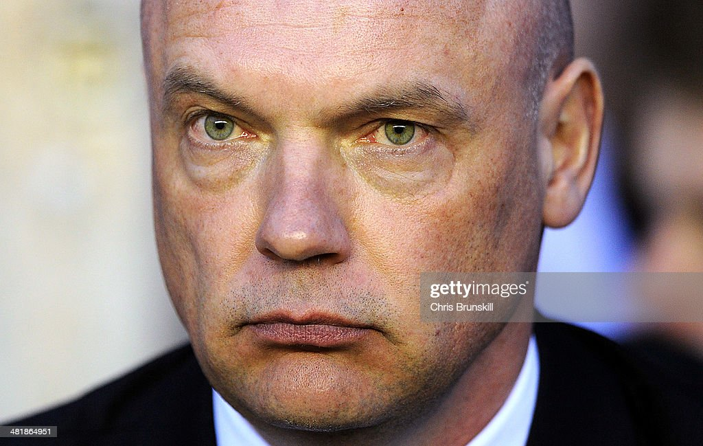 Wigan Athletic manager Uwe Rosler looks on during the Sky Bet Championship match between Wigan Athletic and Leicester City at DW Stadium on April 01, 2014 in Wigan, England.