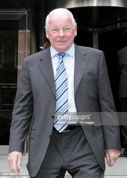 Wigan Athletic owenr David Whelan leaves an employment tribunal in Manchester Tuesday October 4 2005 where he gave evidence in the case of a woman...
