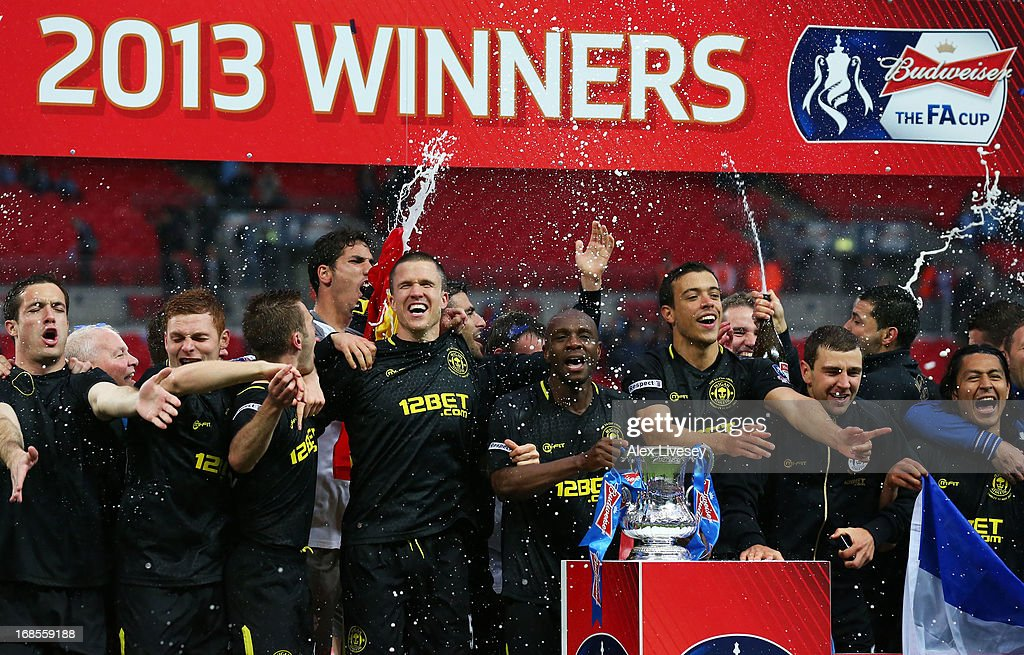 Wigan Athletic players celebrate victory with the trophy after the FA Cup with Budweiser Final between Manchester City and Wigan Athletic at Wembley Stadium on May 11, 2013 in London, England.