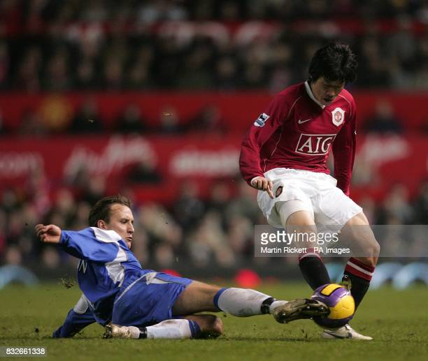 Wigan Athletic's Andreas Johansson tackles Manchester United's JiSung Park