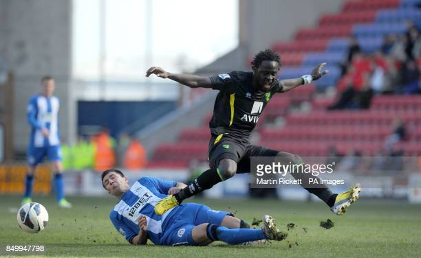 Wigan Athletic's Antolin Alcaraz battles for the ball with Norwich City's Kei Kamara during the Barclays Premier League match at the DW Stadium Wigan