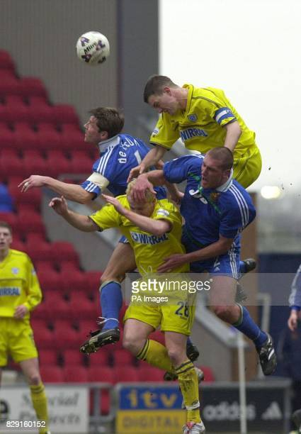 Wigan Athletic's Arjan de Zeeuw and Jason de Vos clash with Tranmere Rovers' Clint Hill and Sean Thornton during their Nationwide Division Two match...