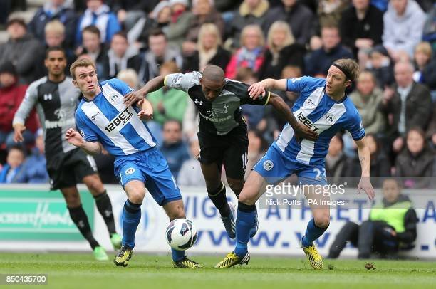 Wigan Athletic's Callum McManaman and Ronnie Stam battle for the ball with Tottenham Hotspur's Jermain Defoe