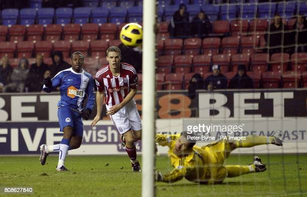 Wigan Athletic's Charles N'Zogbia sees his shot hit the post after the save from Stoke City goalkeeper Asmir Begovic