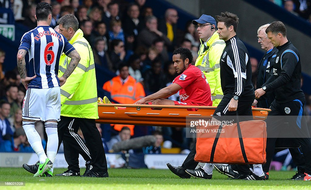 "Wigan Athletic's Chilean midfielder Jean Beausejour is carried from the pitch on a stretcher injured during the English Premier League football match between West Bromwich Albion and Wigan Athletic at The Hawthorns in West Bromwich, central England on May 4, 2013. Wigan won the game 3-2. USE. No use with unauthorized audio, video, data, fixture lists, club/league logos or ""live"" services. Online in-match use limited to 45 images, no video emulation. No use in betting, games or single club/league/player publications"