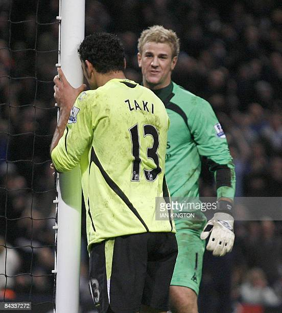 Wigan Athletic's Egyptian player Amr Zaki reacts after missing a chance to score watched by Manchester City's Joe Hart during a Premier League...