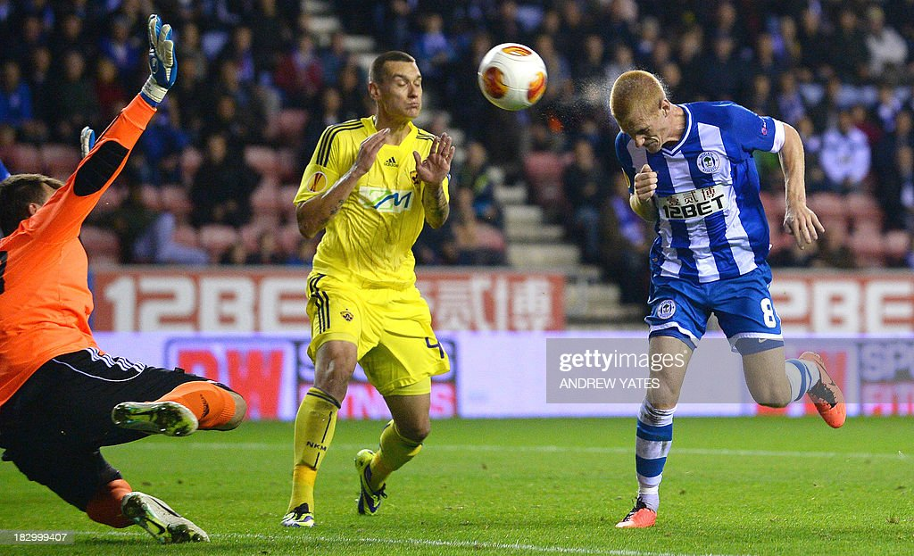 Wigan Athletic's English midfielder Ben Watson (R) heads the second goal during the UEFA Europa League group D football match between Wigan Athletic and NK Maribor at The DW stadium in Wigan, northwest England, on October 3, 2013.
