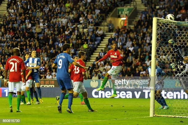 Wigan Athletic's Gary Caldwell looks on as his header is tipped over the bar by Swansea City goalkeeper Michel Vorm