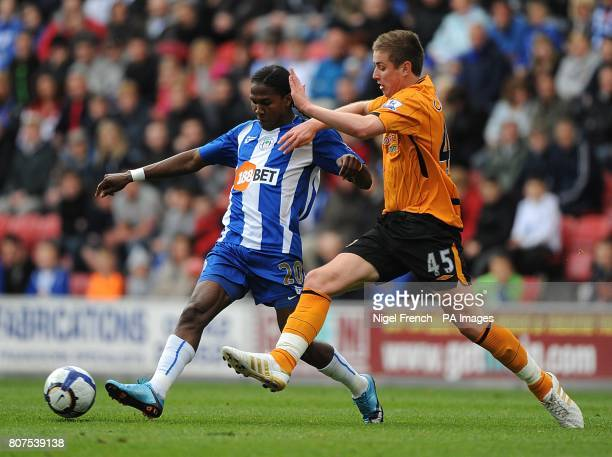 Wigan Athletic's Hugo Rodallega and Hull City's Tom Cairney battle for the ball