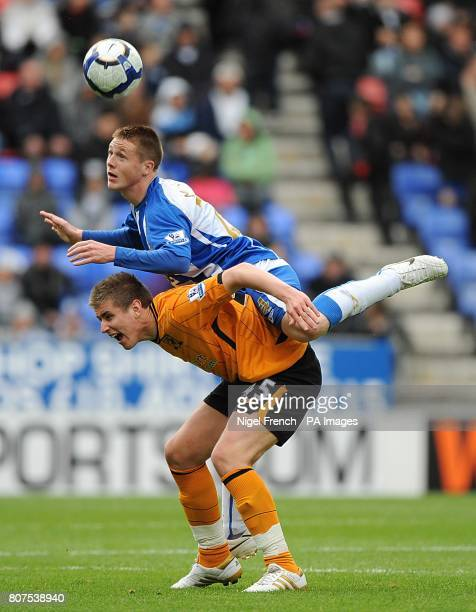 Wigan Athletic's James McCarthy and Hull City's Tom Cairney battle for the ball