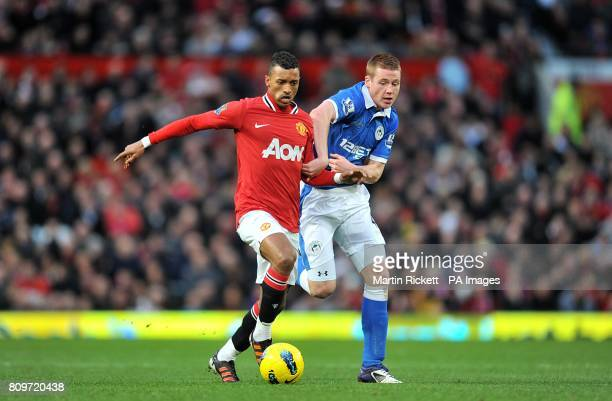Wigan Athletic's James McCarthy and Manchester United's Luis Nani battle for the ball