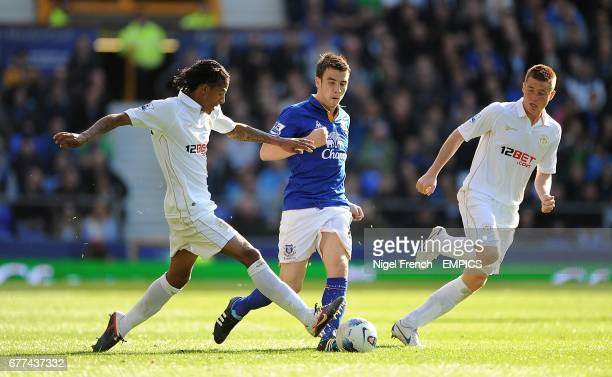 Wigan Athletic's James McCarthy and Patrick Van Aanholt battle for the ball with Everton's Seamus Coleman