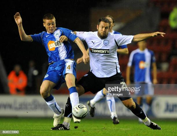 Wigan Athletic's James McCarthy and Preston North End's Jon Parkin battle for the ball during the third round Carling Cup match at the DW Stadium...