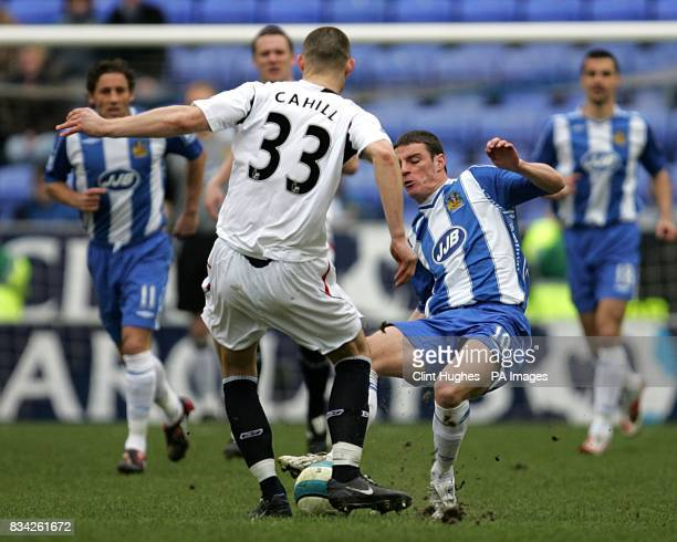 Wigan Athletic's Jason Koumas fouls Bolton Wanderers's Gary Cahill leading to the Wigan man being sent off