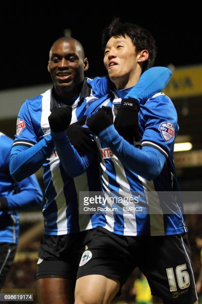 Wigan Athletic's Kim Bo Kyung [right] celebrates his goal with MarcAntoine Fortune