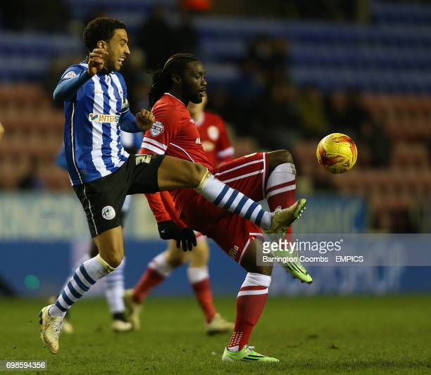 Wigan Athletic's Leon Clarke and Cardiff City's Kenwyne Jones battle for the ball