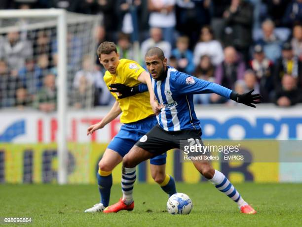 Wigan Athletic's Leon Clarke holds off Derby County's Craig Forsyth