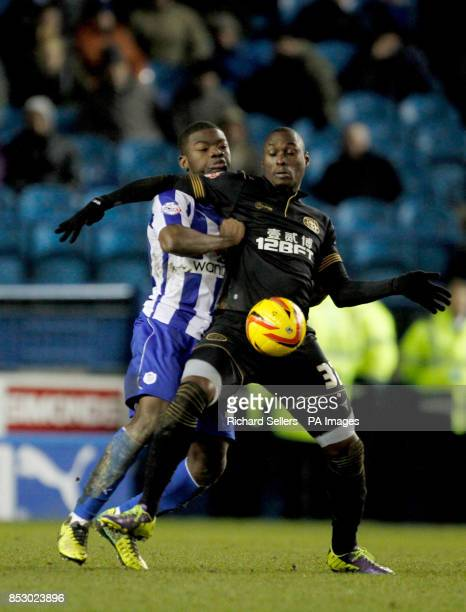 Wigan Athletic's MarcAntoine Fortune and Sheffield Wednesday's Reda Johnson battle for the ball during the Sky Bet Championship at Hillsborough...