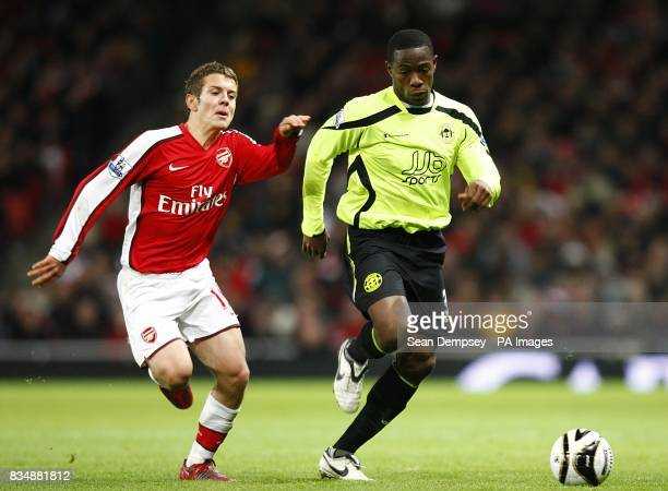 Wigan Athletic's Maynor Figueroa and Arsenal's Jack Wilshere