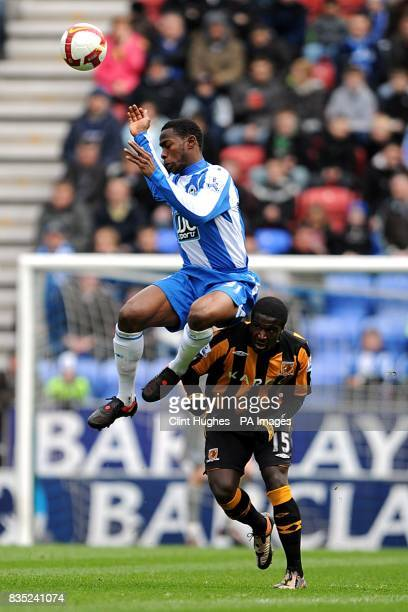 Wigan Athletic's Maynor Figueroa and Hull City's Bernard Mendy battle for the ball