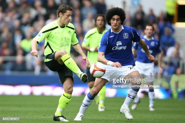 Wigan Athletic's Michael Brown is closed down by Everton's Marouane Fellaini