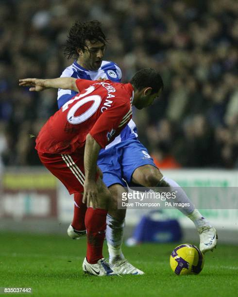 Wigan Athletic's Mido and Liverpool's Javier Mascherano battle for the ball