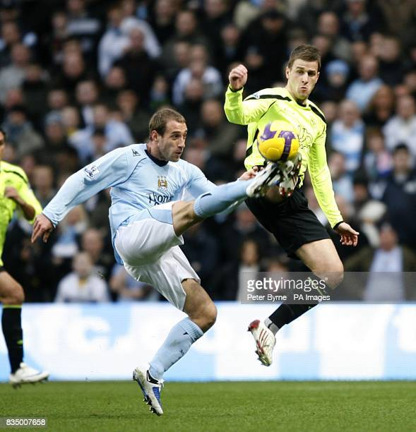 Wigan Athletic's Ryan Taylor and Manchester City's Pablo Zabaleta battle for the ball