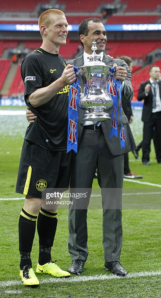 Wigan Athletic's Spanish manager Roberto Martinez (R) and goal scorer Wigan Athletic's English midfielder Ben Watson (L) pose with the FA Cup after winning the English FA Cup final football match between Manchester City and Wigan Athletic at Wembley Stadium in London on May 11, 2013. Substitute Ben Watson scored an injury-time winner to give Wigan Athletic a sensational 1-0 win over Manchester City at Wembley Stadium on Saturday in the biggest FA Cup final upset in 25 years.