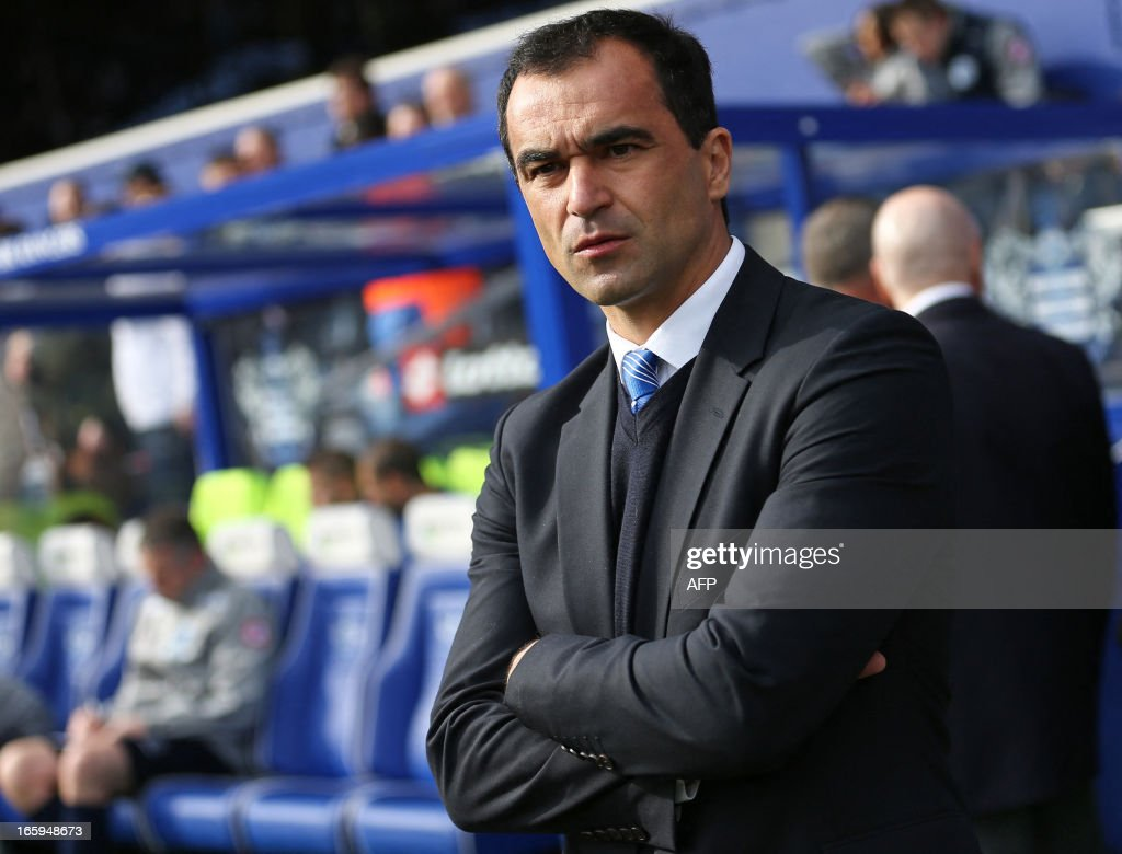 """Wigan Athletic's Spanish manager Roberto Martinez looks on before the English Premier League football match between Queens Park Rangers and Wigan Athletic at the Loftus Road Stadium in London on April 7, 2013. The game finished 1-1. USE. No use with unauthorized audio, video, data, fixture lists, club/league logos or """"live"""" services. Online in-match use limited to 45 images, no video emulation. No use in betting, games or single club/league/player publications."""