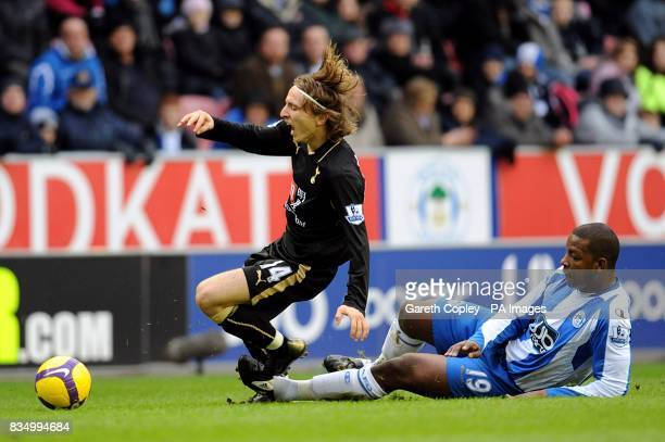 Wigan Athletic's Titus Bramble challenges Tottenham Hotspur's Luka Modric for the ball
