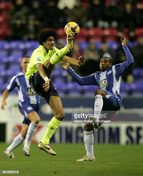Wigan Athletic's Wilson Palacios and Everton's Marouane Fellaini battle for the ball