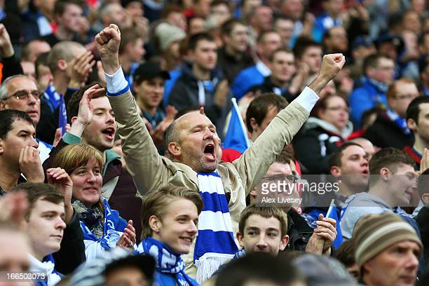 Wigan fans celebrate Shaun Maloney scoring the opening goal by during the FA Cup with Budweiser Semi Final match between Millwall and Wigan Athletic...