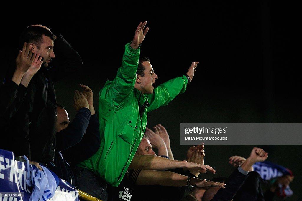 Wigan fans cheer during the UEFA Europa League Group D match between SV Zulte Waregem and Wigan Athletic at the Jan Breydelstadion on September 19, 2013 in Waregem, Belgium.