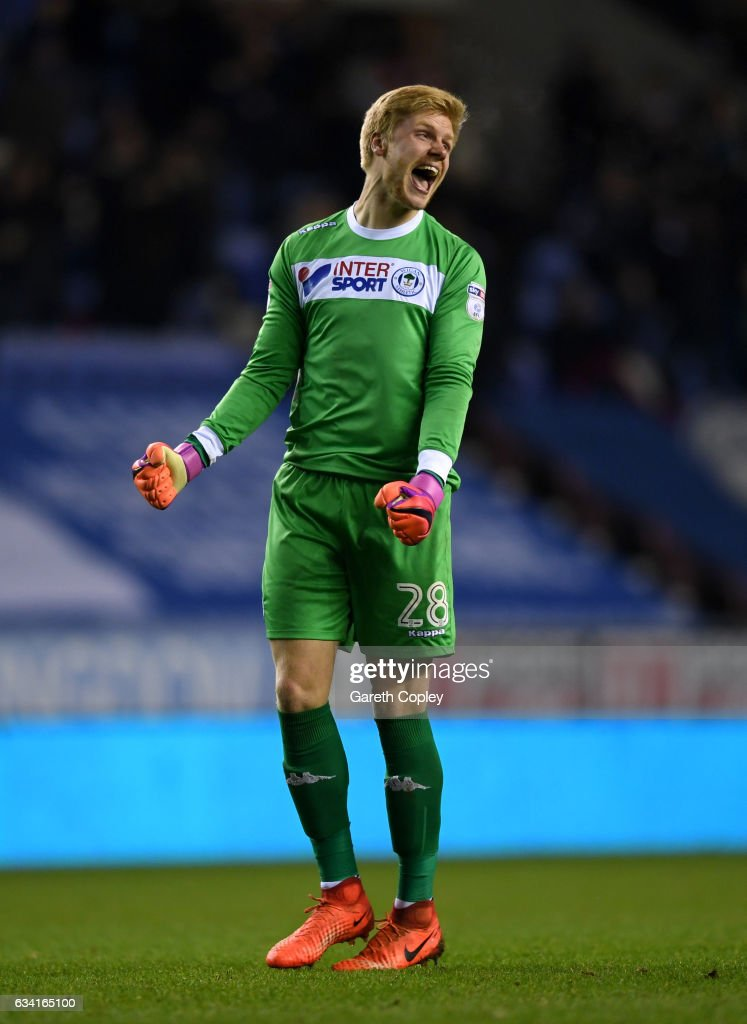 Wigan goalkeeper Jakob Haugaard celebrates Omar Bogle's second goal during the Sky Bet Championship match between Wigan Athletic and Norwich City at DW Stadium on February 7, 2017 in Wigan, England.