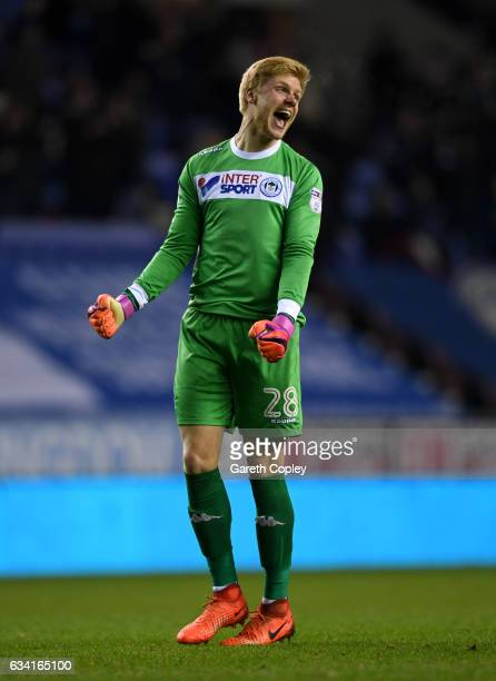 Wigan goalkeeper Jakob Haugaard celebrates Omar Bogle's second goal during the Sky Bet Championship match between Wigan Athletic and Norwich City at...
