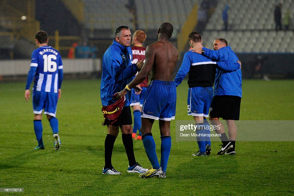 Wigan Manager, <a gi-track='captionPersonalityLinkClicked' href=/galleries/search?phrase=Owen+Coyle&family=editorial&specificpeople=3426356 ng-click='$event.stopPropagation()'>Owen Coyle</a> speaks to Wigan Captain, <a gi-track='captionPersonalityLinkClicked' href=/galleries/search?phrase=Emmerson+Boyce&family=editorial&specificpeople=224080 ng-click='$event.stopPropagation()'>Emmerson Boyce</a> after the UEFA Europa League Group D match between SV Zulte Waregem and Wigan Athletic at the Jan Breydelstadion on September 19, 2013 in Waregem, Belgium.