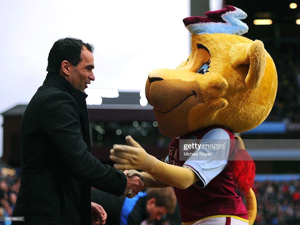 Wigan manager Roberto Martinez (L) is greeted by Aston Villa mascot Hercules the Lion before the Barclays Premier League match between Aston Villa and Wigan Athletic at Villa Park on December 29, 2012 in Birmingham, England.