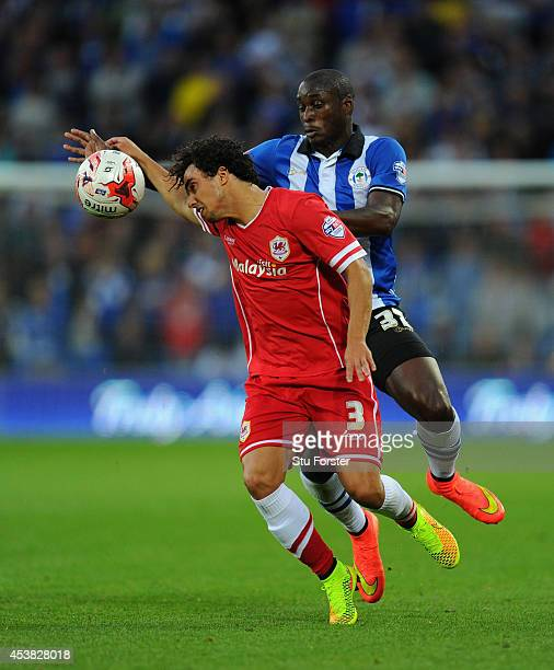 Wigan player Marc Antoine Fortune challenges Fabio Da Silva of Cardiff during the Sky Bet Championship match between Cardiff City and Wigan Athletic...