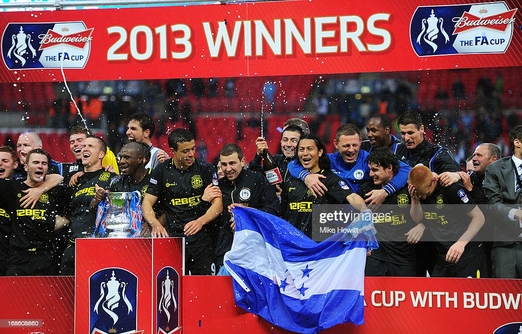 Wigan players celebrate following their team's 10 victory during the FA Cup with Budweiser Final between Manchester City and Wigan Athletic at...