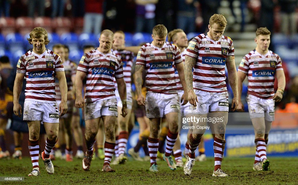 Wigan players leave the field after losing the World Club Series match between Wigan Warriors and Brisbane Broncos at DW Stadium on February 21 2015...