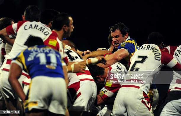 Wigan Warriors and Leeds Rhinos players battle as a mass fight breaks out following a penalty conceded by Wigan's Mark Calderwood during the Engage...