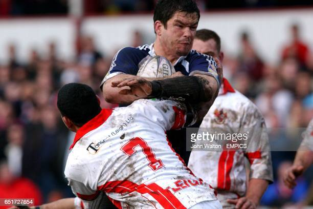 Wigan Warriors' Andy Farrell bursts past Leigh Centurions' Willie Swann to score their first try of the game