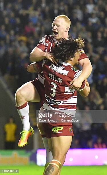 Wigan Warriors' Anthony Gelling is congratulated by Liam Farrell after scoring the winning try during the First Utility Super League Super 8s Round 6...